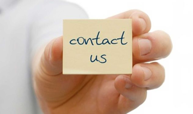 Contact Us - Hand Holding Post-It note